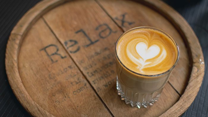 Coffee on a tray with the word Relax