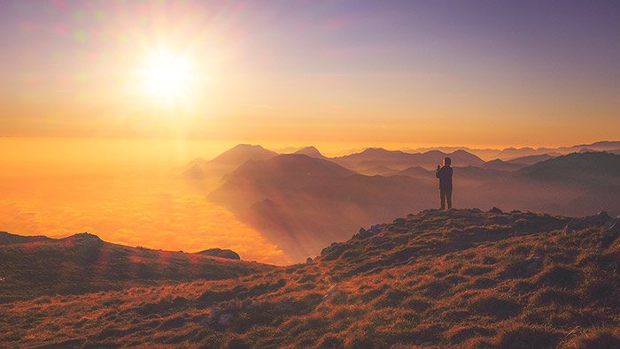Mindfulness - Anxiety To Presence - Person looking down on clouds