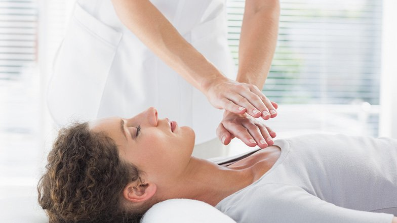 Reiki Healer at work with client.