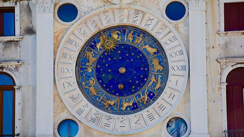 Zodiac Clock on old building.