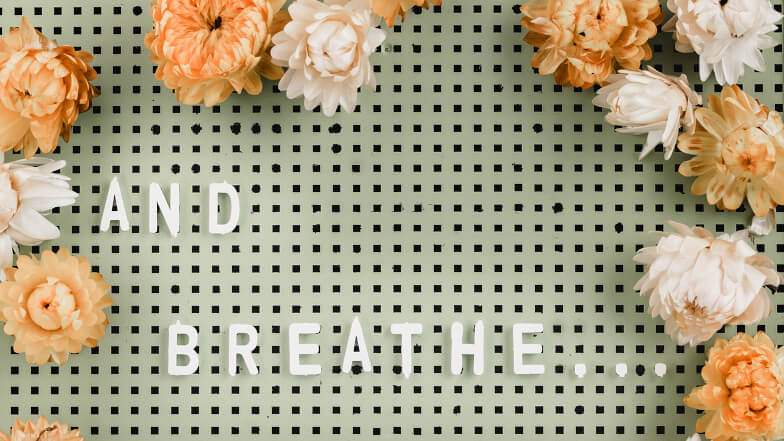 And-Breathe on letter-board with dried flowers.