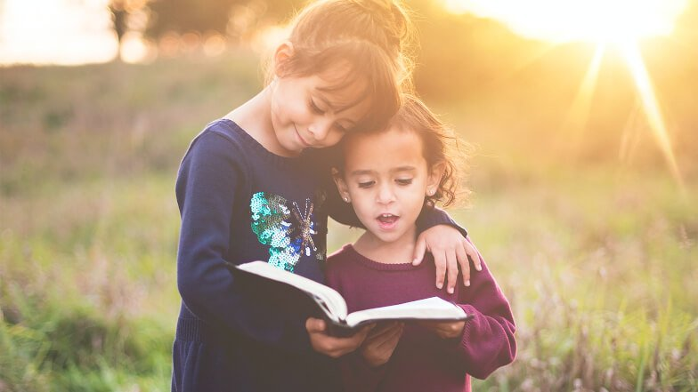 Mindfulness for Children - two girls reading from book