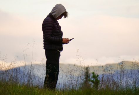 Mindfulness For Teenagers - Teenage boy sending text message